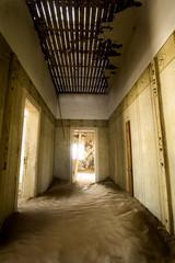 Sandy  abandoned corridor in Kolmanskop - Namibia