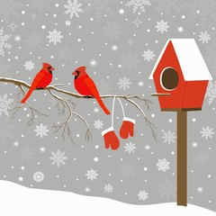Red birds on branch and birdhouse