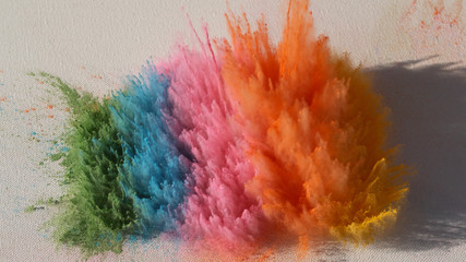 Bright rainbow Holi powder background 2