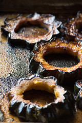 caramelized slices of acorn squash on baking pan