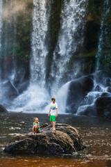 Kids swimming in waterfall