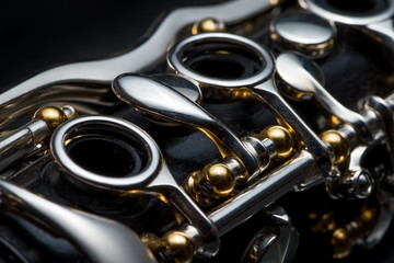 Details of a clarinet with silver keys and golden sockets Wall mural