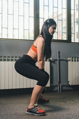 Woman workout with kettlebell at the gym
