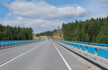 """The summer landscape is a motorway in the middle of northern nature. Federal highway A-121 """"Sortavala"""" in Karelia"""