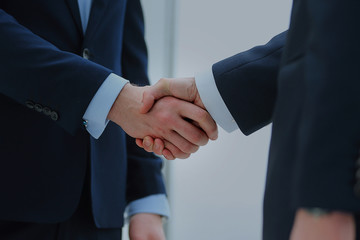 handshake of two businessmen in office