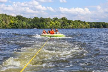 People tubing on an inland lake
