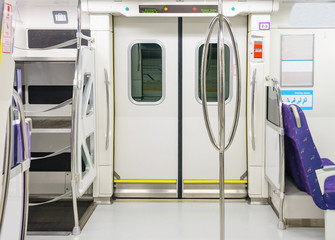 Empty interior of the train for long and short distance in Taiwan train carriage with purple seats