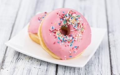 Pink glazed Donuts (close-up shot)