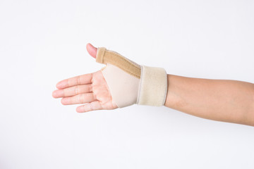 Close up hand wrist support on white background.Supporter wrist before sport.
