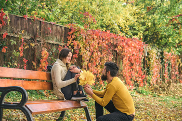 Autumn happy couple of girl and man outdoor