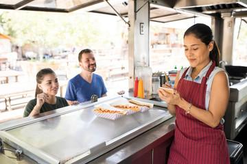 Woman taking orders in a food truck