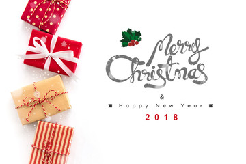 Merry Christmas and Happy New Year 2018 text on white background with gift boxes