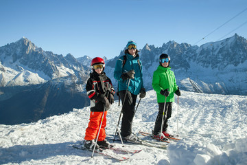 Father with two children on mountain in the ski resort