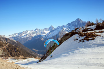 A paraglider takes off in Chamonix valley
