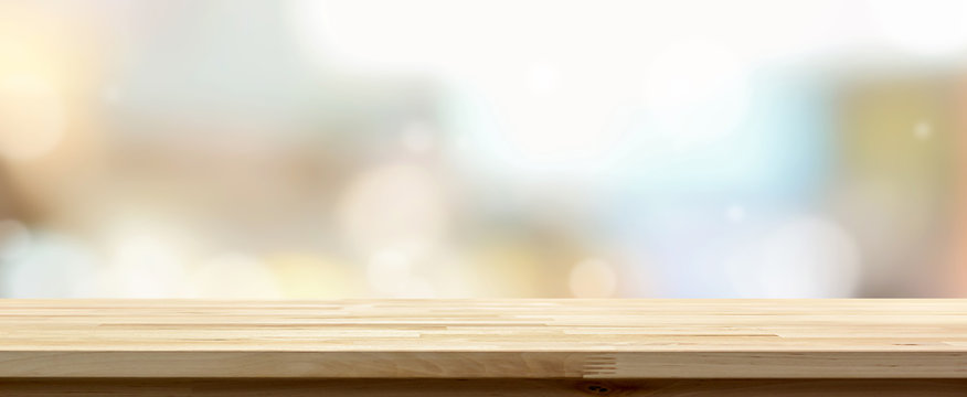 Wooden table top against cafe background