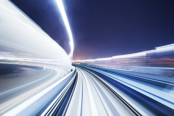 speed railroad track and modern city