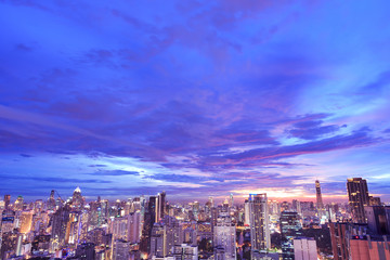 dramatic beautiful purple sky at sunset over cityscape