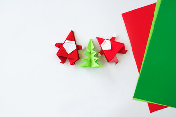 Lesson of origami. Santa Claus of origami a fir-tree of origami from paper
