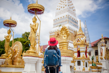 Asian woman backpacker solo travels and lifestyle at ancient in Thailand