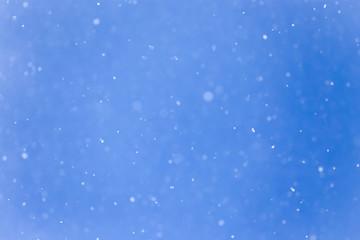 snowing on a blue sky