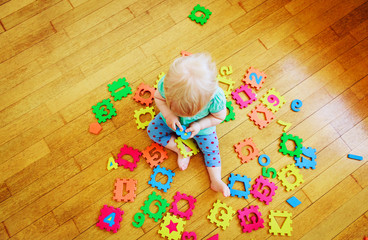little toddler girl learning numbers, education concept