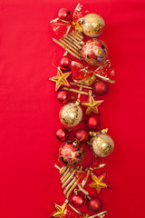 Christmas garland gold and red balls with bows and stars
