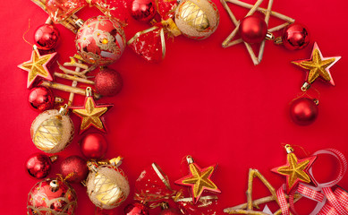 Red Christmas background with Golden baubles and stars