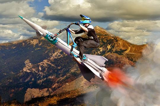 Conceptual image of biker flying up upwards on a rocket