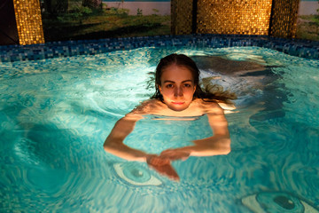 Wet girl in the swimming-pool