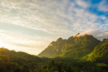 Beautiful nature scenery of fresh green tropical mountain range with morning sunlight
