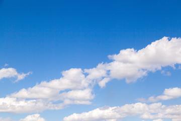 The blue sky with clouds in sunny day