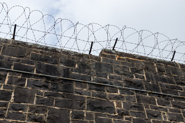 Bluestone prison walls at J Ward in Ararat, Australia