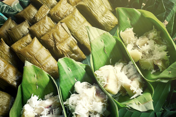 Thai style dessert Sticky Rice wrapped with banana leafs by steaming.selective focus