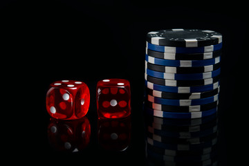 on a black background, two red dice and a bet for the game