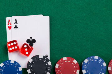 on the green game table, a set of objects for playing money on cards