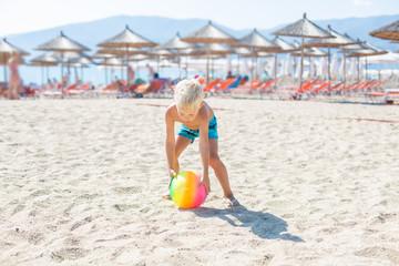 Little boy playing Beach Volleyball