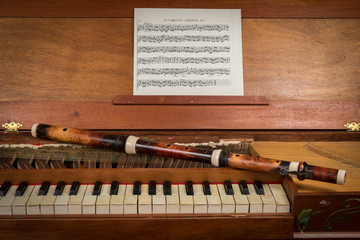 An old baroque clavichord and wooden traverse flute