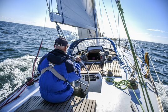 Skagen, Denmark, 31 July 2017:  A lone sailor behind the helm on the North Sea