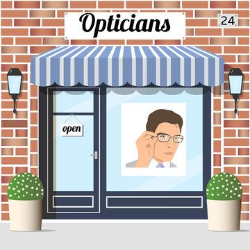 Opticians shop building with red bricks facade.