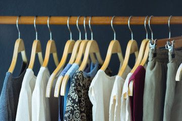 Female clothes hanging on clothesline with variety of color and style. Vintage clothes.