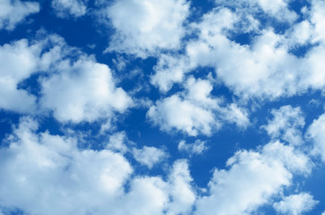 Background of blue sky with white and gray clouds.