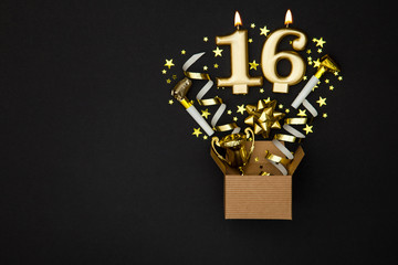 Number 16 gold celebration candle and gift box background