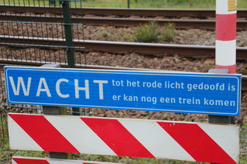 Sign at railroad crossing to warn that another train can come