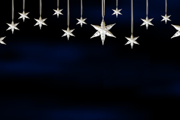 Christmas Stars hanging with blue background