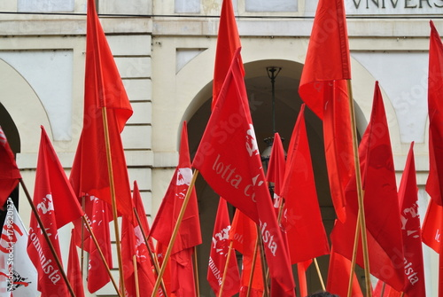 Turin, Italy - 1 May 2010: demonstration for Labor Day red flags and