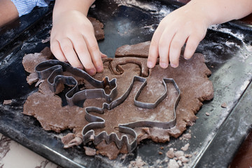 children, gingerbread - children cutting gingerbread dough. Christmas preparations, common family pastries and desserts