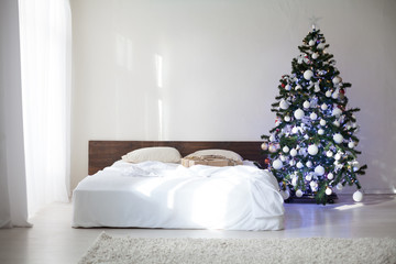 bedroom with christmas new year tree decoration bed