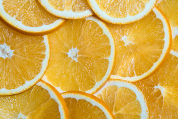 Sliced oranges background, bright fresh fruit cut into even slices