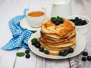 Plate with pancakes and blueberries