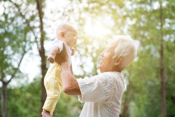 Grandparent holding grandchild.